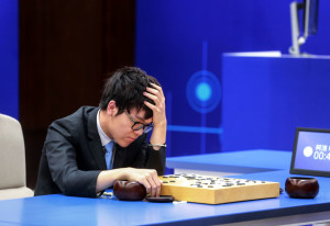 China's 19-year-old Go player Ke Jie reacts during the second match against Google's artificial intelligence programme AlphaGo in Wuzhen, eastern China's Zhejiang province on May 25, 2017.  Chinese netizens fumed on May 25 over a government ban on live coverage of Google algorithm AlphaGo's battle with the world's top Go player, as the programme clinched their three-match series in the ancient board game. / AFP PHOTO / STR / China OUT        (Photo credit should read STR/AFP/Getty Images)